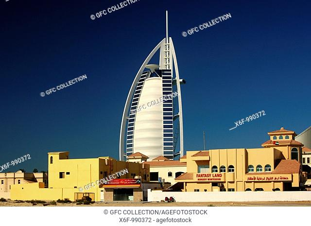Contrasts, Fantasy Land Montessori Nursery, in the back Burj al Arab Hotel, Dubai, United Arab Emirates