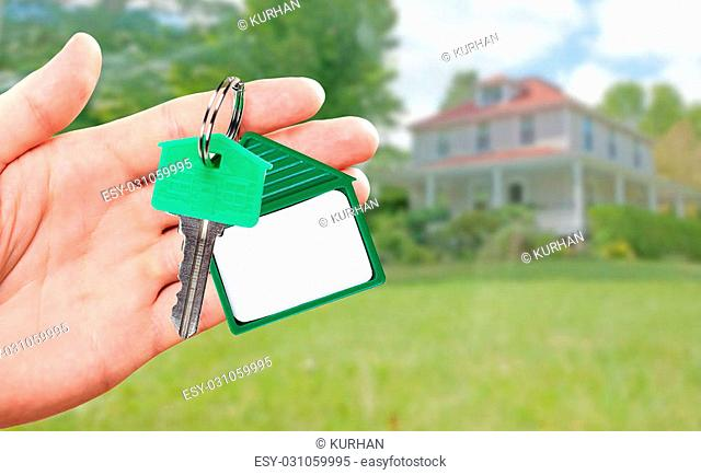 Woman hand giving house key. Real estate broker agent