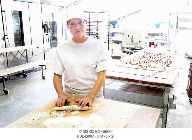 Baker rolling bread dough