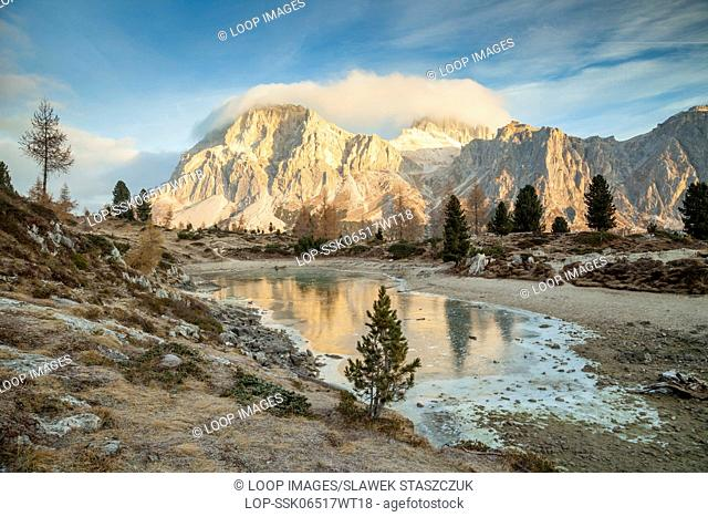 Frosty morning at the frozen lake of Limides in the Dolomites