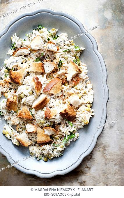 Still life of dish with rice salad and bread