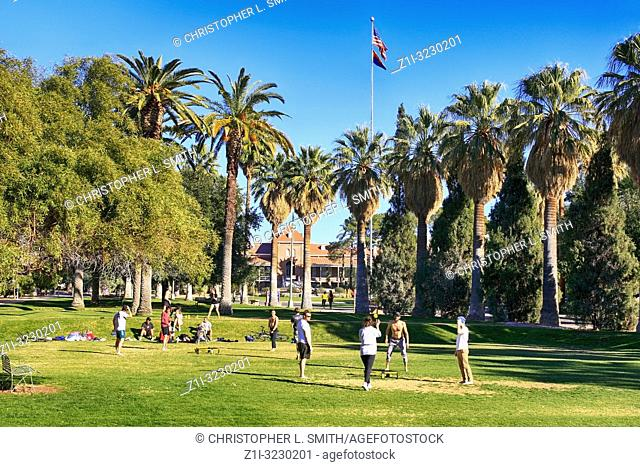 Students playing a form of volleyball on the University of Arizona Campus in Tucson AZ