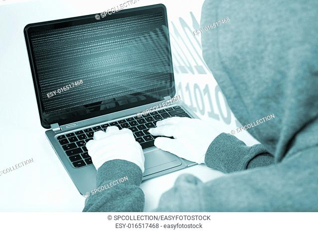 hacker on computer with white gloves