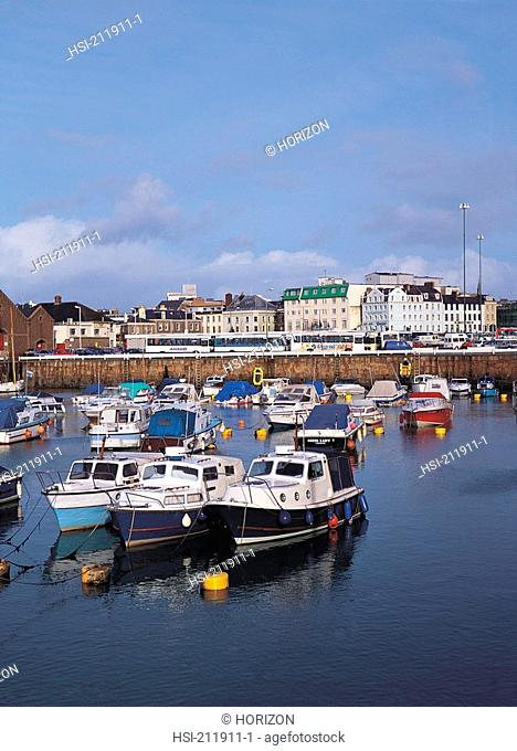 Harbour scene with boats and buildings in Saint Helier, Jersey, Channel Islands