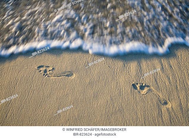 Footprints on a beach, Nosy Nato, Madagascar, Africa