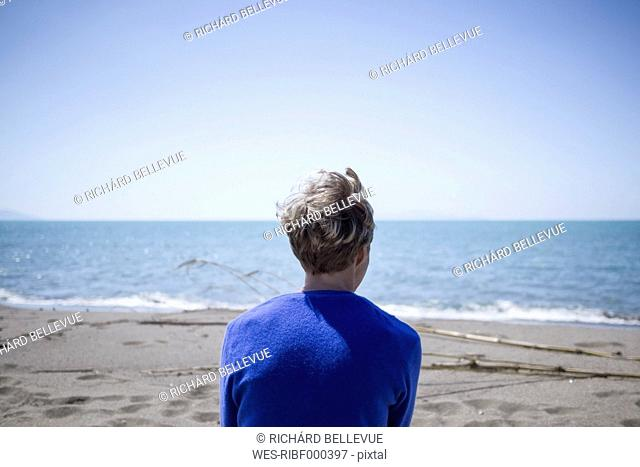 Back view of woman in front of the sea