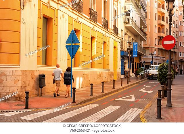 Couple walking on the streets, Alicante, Spain