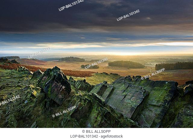 England, Leicestershire, Newton Linford. A view across craggy rocks toward Charnwood Forest