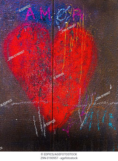"red heart on a rusty metal door and the wor: """"amor"""", paris, ile de france, france"