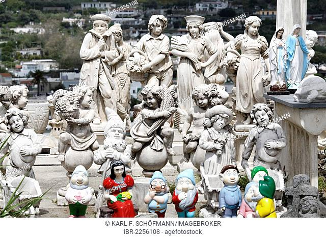 Concrete figures in an open-air exhibition, colourful mixture of putti, garden gnomes and statues of the Virgin Mary, Ischia Island, Gulf of Naples, Campania