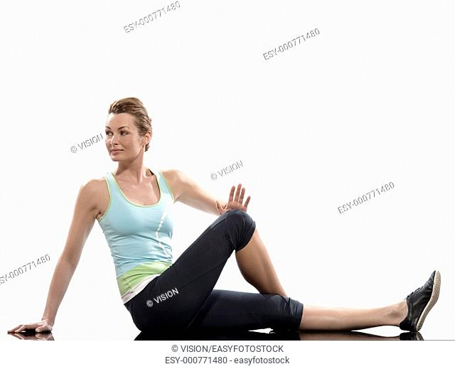 woman on Abdominals rotation workout posture on white background  Sit up, straighten one leg and bend the other one  Hold the knee and bring it towards you for...