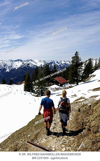 Hikers, snow near Hubertushuette mountain hut on Breitenstein mountain, near Fischbachau, Leitzachtal valley, Upper Bavaria, Bavaria, Germany, Europe