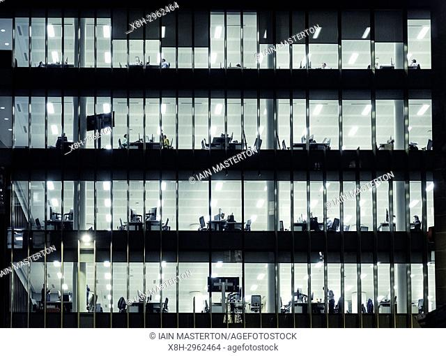 View of offices at night in Standard Life building on St Andrews Square in Edinburgh, Scotland, united Kingdom