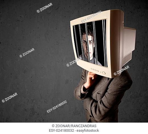 Business man with monitor on his head traped into a digital system concept