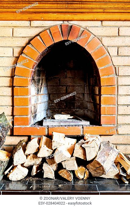 not kindled brick fireplace and wood logs