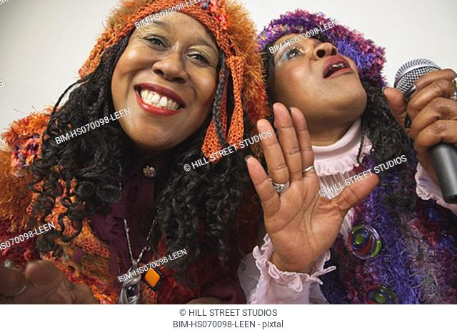 Two senior African women singing