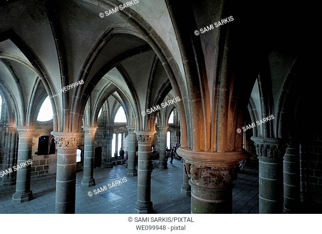 Columns and rib vaults inside the abbey at Mont Saint-Michel, a fortified medieval monastery on an island in Normandy, France