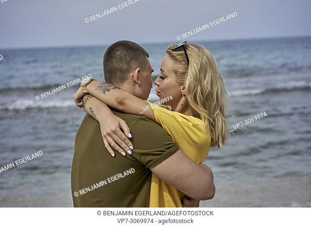 Young couple embracing on the beach, Russian ethnicity, Hersonissos, Crete, Greece