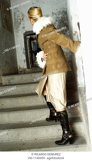 AUSTRIA , VIENNA , 11.02.2008, Young woman wearing a winter jacket standing in a stairwell - Vienna, Vienna, AUSTRIA, 11/02/2008