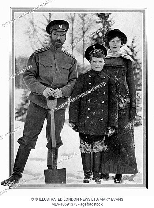 Tsar Nicholas II of Russia pictured with two of his children, the Grand Duchess Tatiana and Alexei, the Tsarevitch, building a fortification from snow in the...