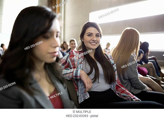 Portrait confident student in auditorium audience