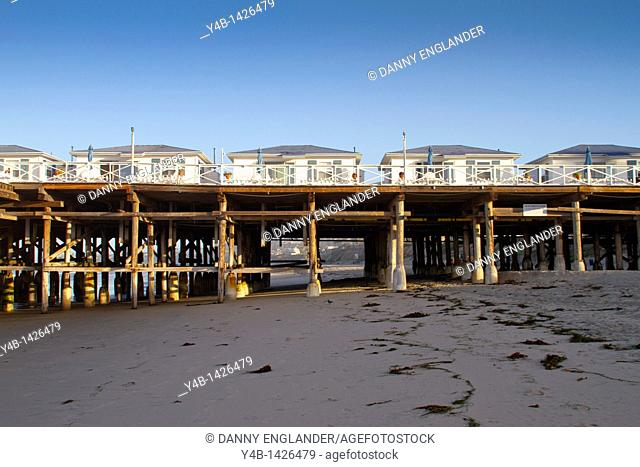 Cottages and pier at sunset, Crystal Pier Hotel, Pacific Beach, San Diego, California
