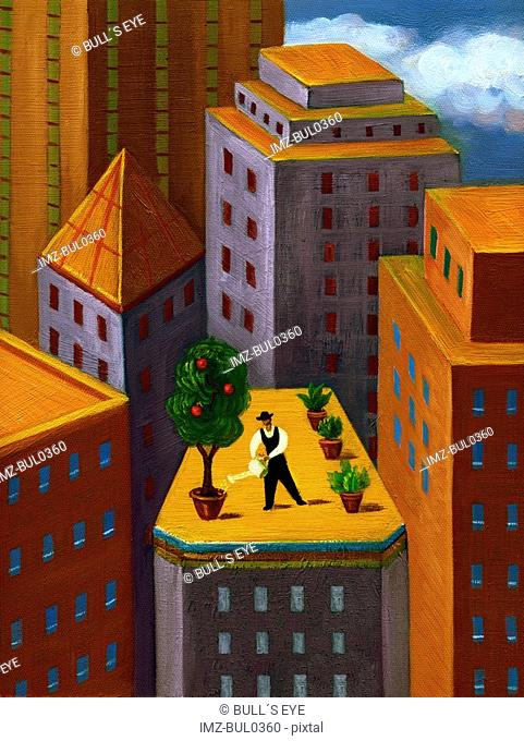 A man watering a garden on top of a high rise building in the city