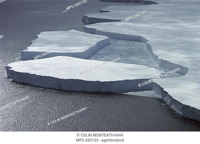 Tabular icebergs breaking off Mertz Glacier, Terre Adelie Coast, Antarctica