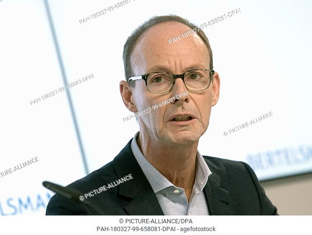 27 March 2018, Germany, Berlin: Thomas Rabe, CEOof Bertelsmann, presenting the Bertelsmann group's 2017 financial statement during a press conference