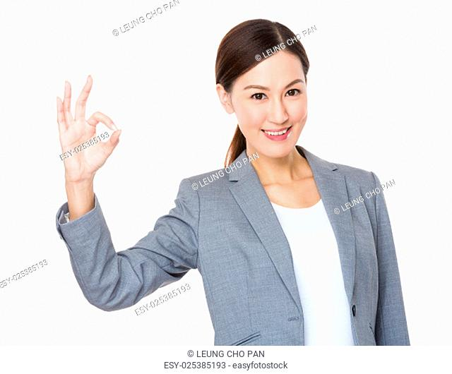 Asian businesswoman with ok gesture