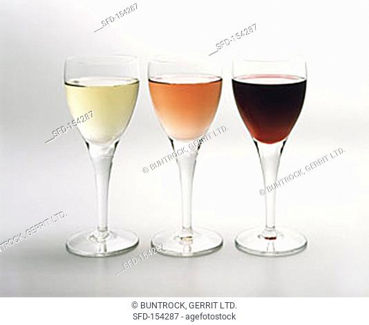 White, red and rose wine in glasses