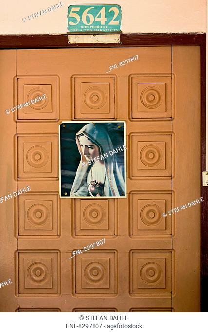 Picutre of Saint on a door, Makati City, Manila, Luzon, Philippines, Aisa