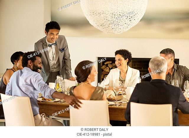 Friends talking at dinner party
