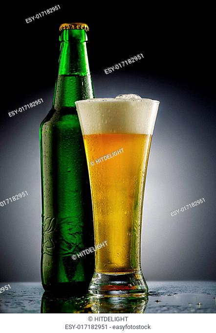 Beer glass in forn of black background