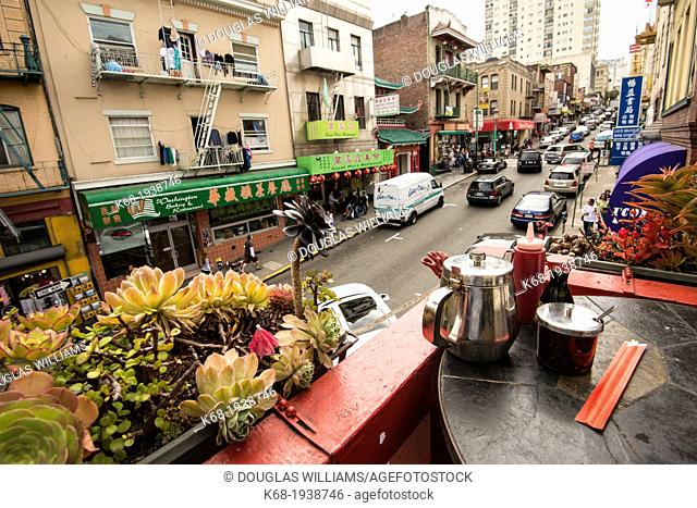 view of Washington Street from a balcony of a restaurant in Chinatown, San Francisco, California, USA