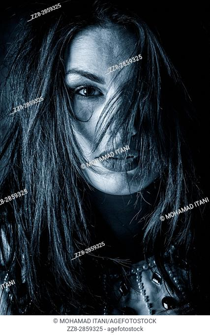 Scared young woman hair covering face