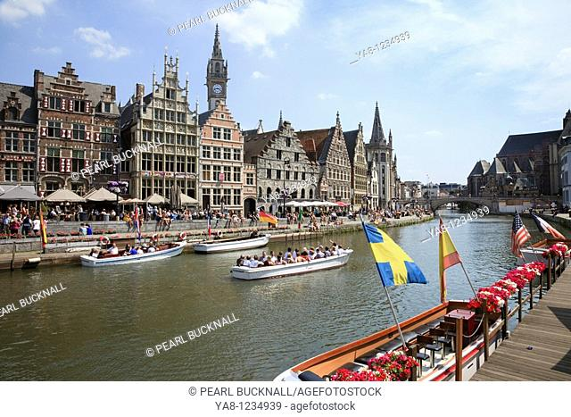Korenlei Site, Ghent, East Flanders, Belgium, Europe  View across the River Leie to medieval guild houses on Graslei quay and St Michaels bridge in the...