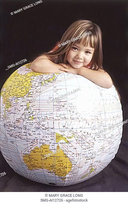 Girl leaning on globe