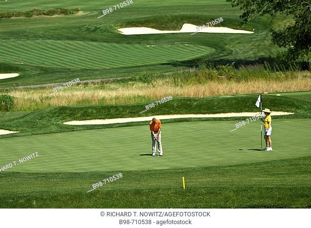 Golfer putting on golf course at Historic Bedford Springs Resort, Pennsylvania