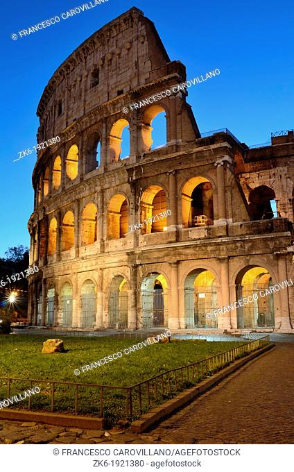 The Colosseum photographed at dawn lit by artificial light with clear sky in the background  This photograph shows the Colosseum originally Amphitheatrum...