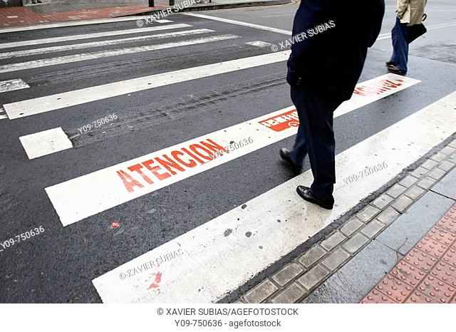 Safety sign on pedestrian crossing, Bilbao. Biscay, Basque Country, Spain