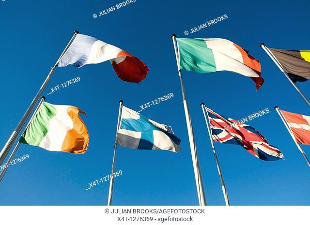 European flags flying against a deep blue sky