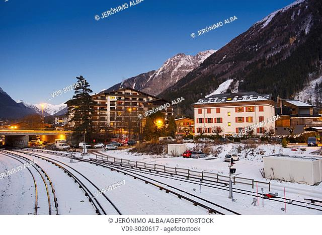 Train tracks and snow at dusk. Chamonix Mont Blanc, Auvergne-Rhône-Alpes, department of Upper Savoy. France Europe