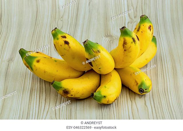 Fresh Baby bananas on the wood background