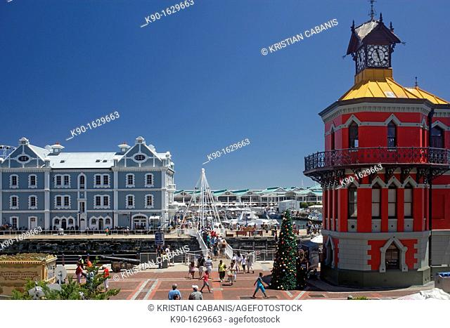 Old warehouse with bridge, Clock Tower, Victoria Wharf and people at waterfont, blue sky, sunny day, Cape Town, South Africa