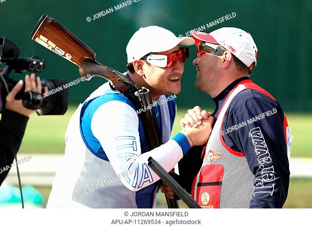 27 04 2012 London, England The winner of the Mens Trap competition Fabbrizi Massimo ITA shakes hands with silver medalist Alexey Alipov RUS