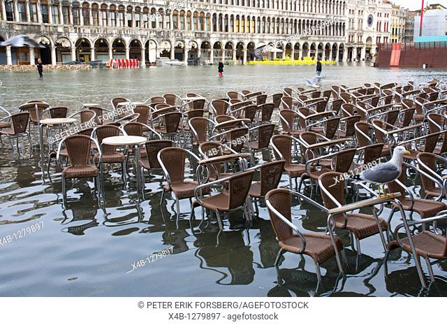 Cafe chairs and tables under water Piazza San Marco during high tide floods San Marco district Venice the Veneto northern Italy