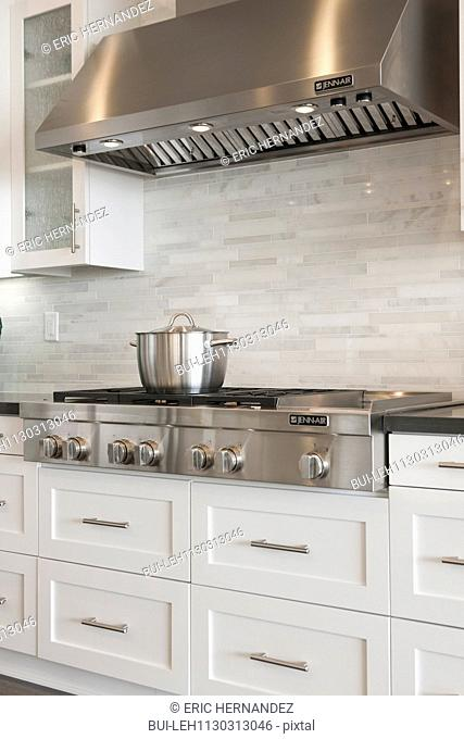 Container on gas stove in domestic kitchen