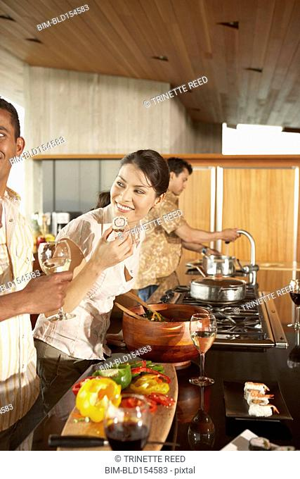 Friends cooking in modern kitchen