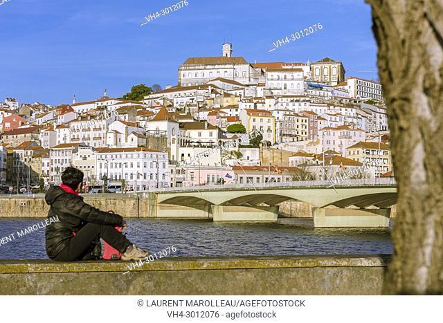 Woman Watching the University Town of Coimbra with Mondego River and Santa Clara Bridge. Coimbra, Baixo Mondego, Centro Region, Portugal, Europe